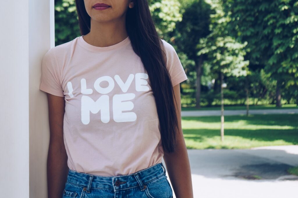 """Girl is wearing t-shirt with a text """" I love me"""""""