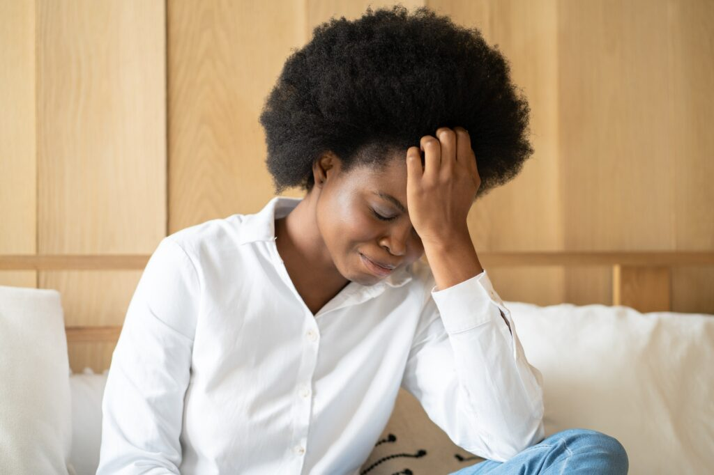Lonely Black woman having depression, suffer from grief, panic attack, psychological troubles